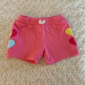 Pink shorts with heart detail on each side